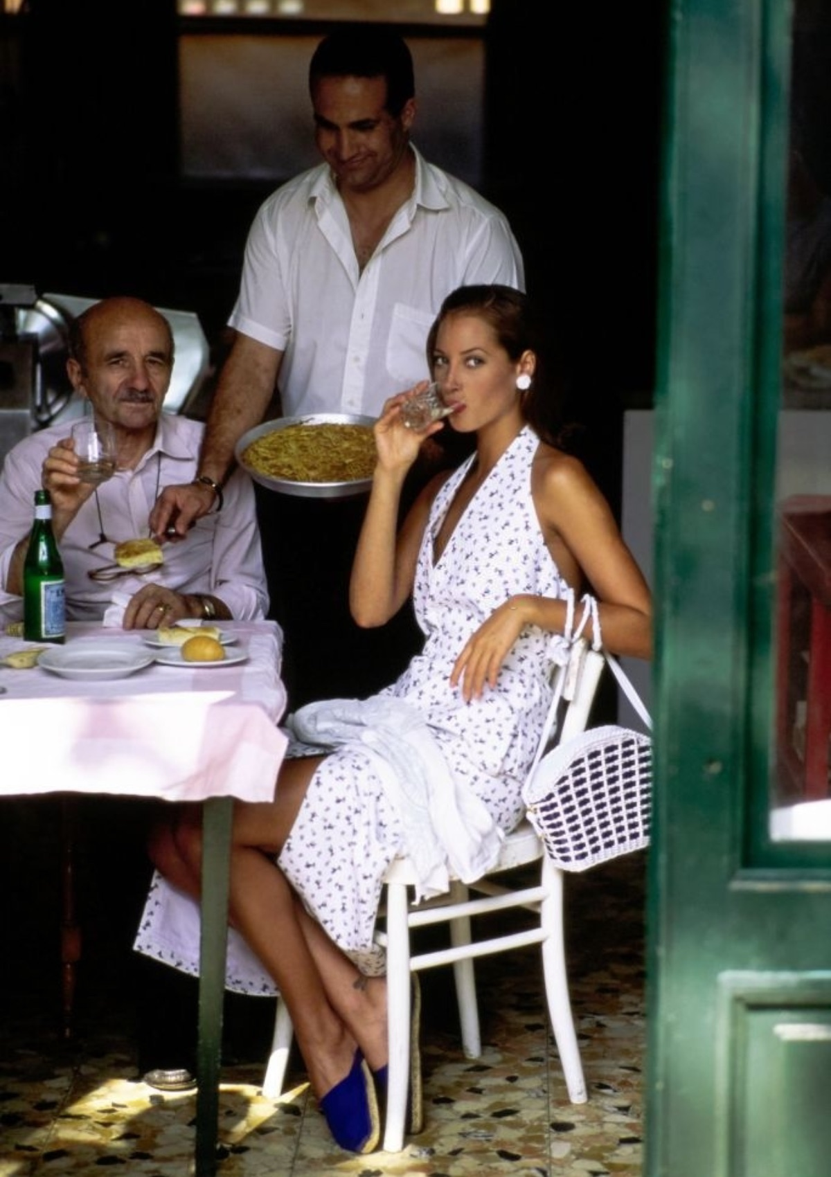 The model Christy Turlington at lunch in a restaurant in Portofino